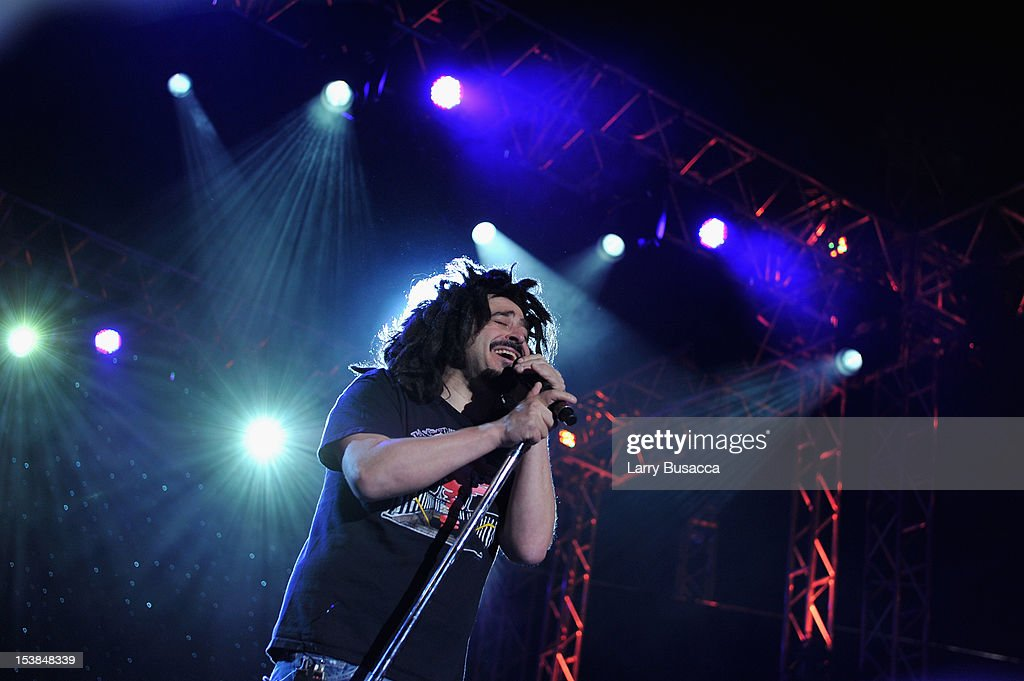 Adam Duritz of Counting Crows performs onstage at the One World Concert at Syracuse University on October 9 2012 in Syracuse New York
