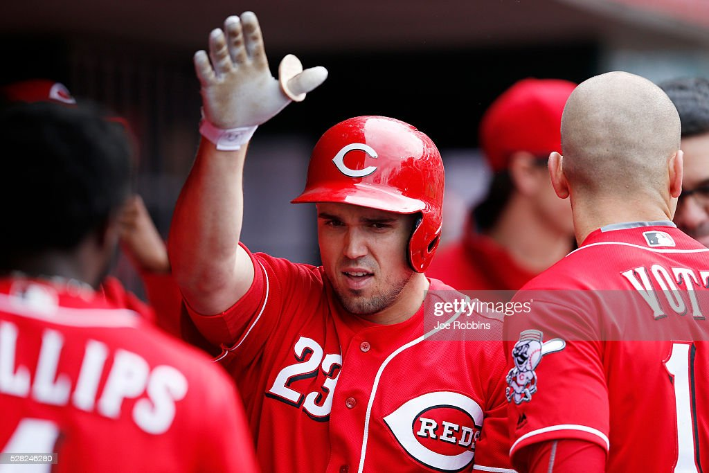 Adam Duvall #23 of the Cincinnati Reds celebrates in the dugout after a solo home run against the San Francisco Giants in the sixth inning of the game at Great American Ball Park on May 4, 2016 in Cincinnati, Ohio. The Reds defeated the Giants 7-4.