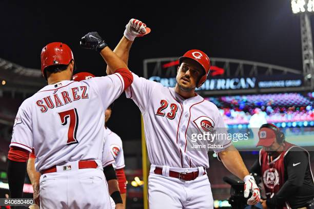 Adam Duvall of the Cincinnati Reds celebrates with Eugenio Suarez of the Cincinnati Reds after hitting a threerun home run in the eighth inning...