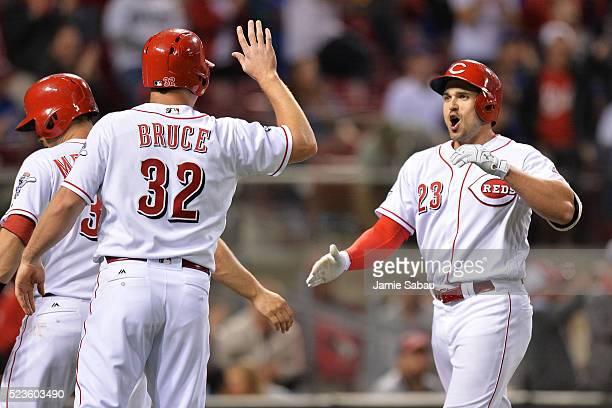 Adam Duvall of the Cincinnati Reds celebrates with Jay Bruce of the Cincinnati Reds at home plate after Duvall hit a threerun home run in the sixth...
