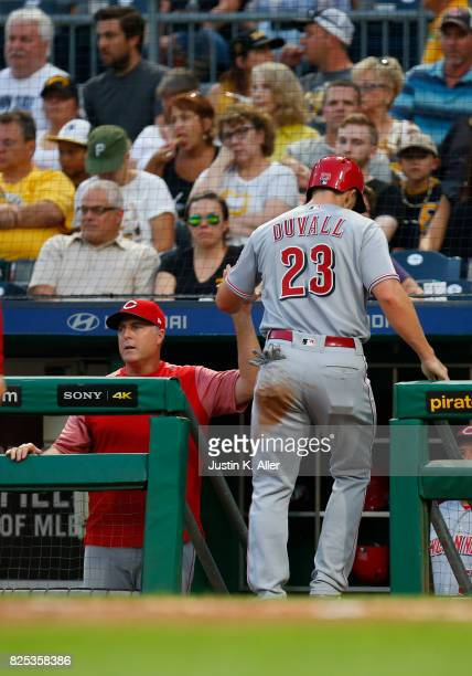 Adam Duvall of the Cincinnati Reds celebrates with Manager Bryan Price of the Cincinnati Reds in the third after scoring on a sacrifice fly against...