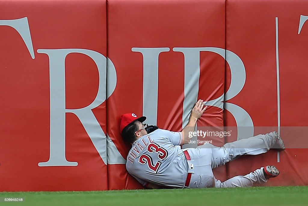 Adam Duvall #23 of the Cincinnati Reds collides with the wall after missing a ball hit by Sean Rodriguez #3 of the Pittsburgh Pirates (not pictured) during the seventh inning on May 1, 2016 at PNC Park in Pittsburgh, Pennsylvania.