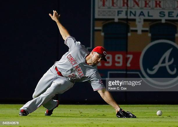 Adam Duvall of the Cincinnati Reds fails to field this double hit by Mallex Smith of the Atlanta Braves in the 10th inning at Turner Field on June 15...