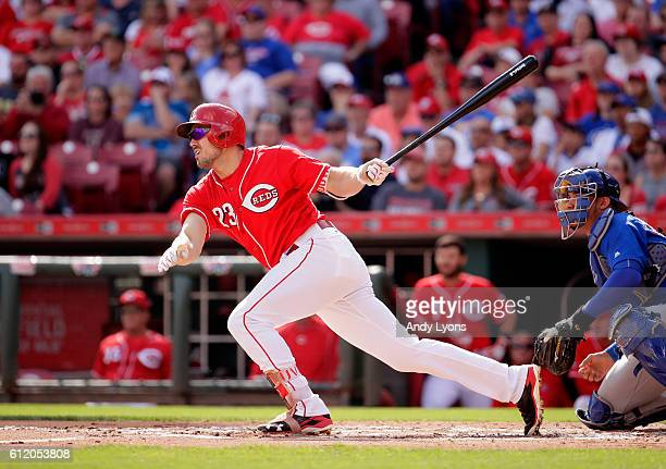 Adam Duvall of the Cincinnati Reds hits a single in the first inning during the game against the Chicago Cubs at Great American Ball Park on October...