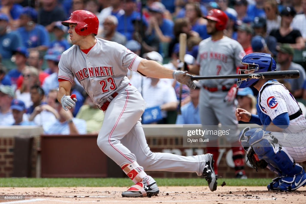 Adam Duvall #23 of the Cincinnati Reds hits a single in the second inning against the Chicago Cubs at Wrigley Field on August 17, 2017 in Chicago, Illinois.