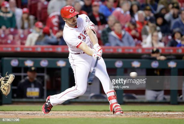 Adam Duvall of the Cincinnati Reds hits the ball in the fourth inning against the Pittsburgh Pirates at Great American Ball Park on May 1 2017 in...
