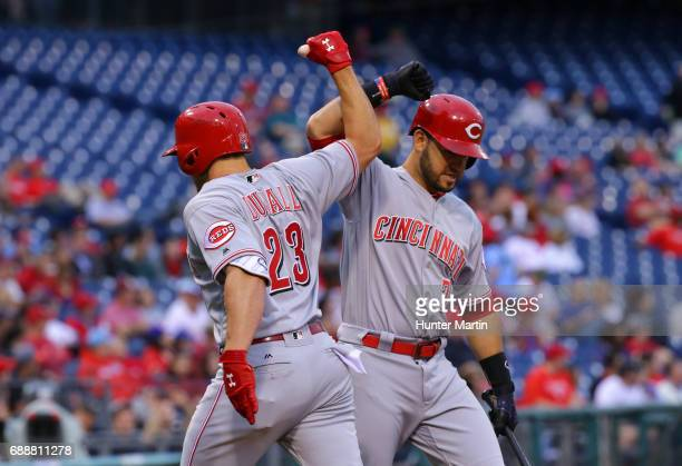 Adam Duvall of the Cincinnati Reds is congratulated by Eugenio Suarez after hitting a home run in the first inning during a game against the...