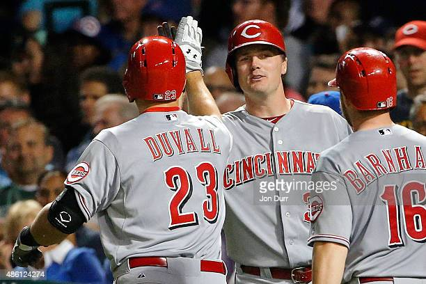 Adam Duvall of the Cincinnati Reds is congratulated by Jay Bruce after hitting a two run home run against the Chicago Cubs during the sixth inning to...