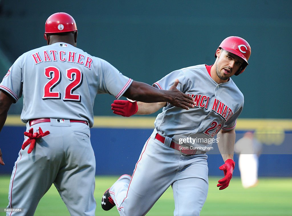 Adam Duvall of the Cincinnati Reds is congratulated by Third Base Coach Billy Hatcher after hitting a first inning tworun home run against the...