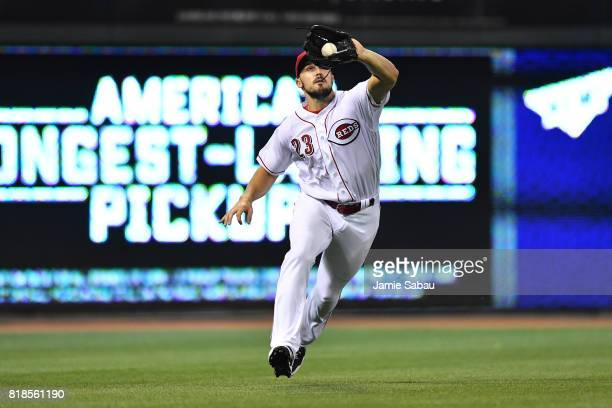 Adam Duvall of the Cincinnati Reds makes a running catch of a fly ball in the sixth inning against the Arizona Diamondbacks at Great American Ball...