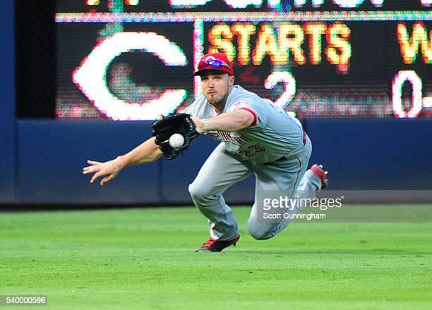 Adam Duvall of the Cincinnati Reds makes a third inning diving catch against the Atlanta Braves at Turner Field on June 13 2016 in Atlanta Georgia