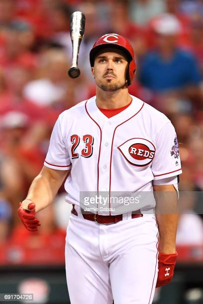Adam Duvall of the Cincinnati Reds reacts by tossing his bat after swinging and missing a pitch in the sixth inning against the Atlanta Braves at...