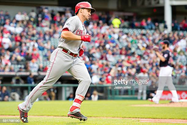 Adam Duvall of the Cincinnati Reds rounds the bases after hitting a solo home run during the second inning against the Cleveland Indians at...