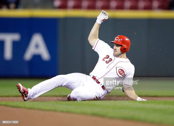 Adam Duvall of the Cincinnati Reds slides into second base for a double in the seventh inning against the Philadelphia Phillies at Great American...