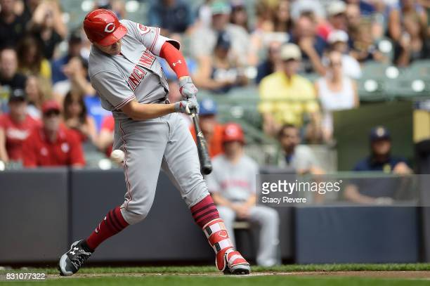 Adam Duvall of the Cincinnati Reds swings at a pitch during the first inning against the Milwaukee Brewers at Miller Park on August 13 2017 in...