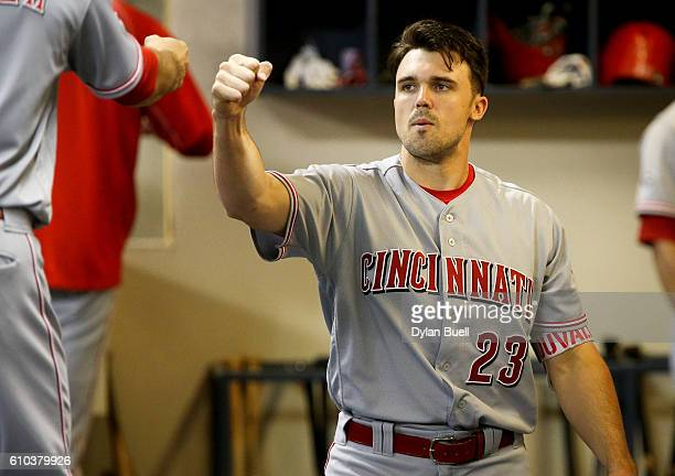 Adam Duvall of the Cincinnati Reds walks through the dugout before the game against the Milwaukee Brewers at Miller Park on September 23 2016 in...