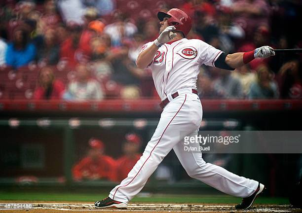 Adam Duvall of the Cincinnati Reds watches the ball after making contact during a resumed game against the St Louis Cardinals at Great American Ball...