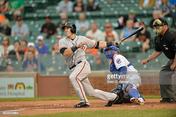 Adam Duvall of the San Francisco Giants bats during the sixth inning of a resumed game against the Chicago Cubs at Wrigley Field on August 21 2014 in...