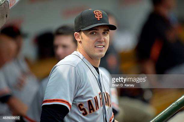 Adam Duvall of the San Francisco Giants stands in the dugout before the game against the Chicago Cubs at Wrigley Field on August 19 2014 in Chicago...