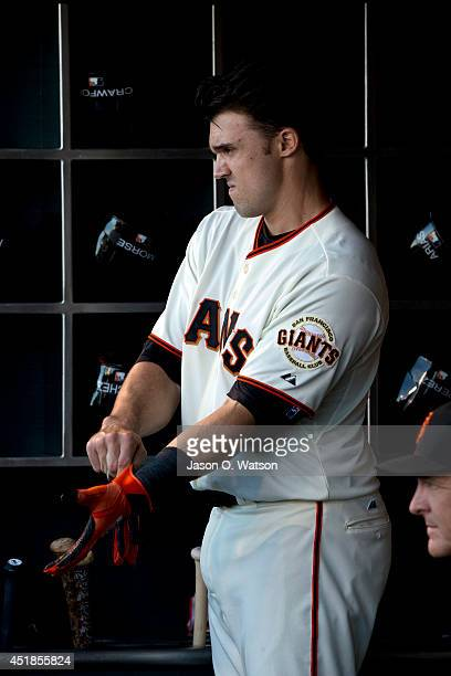 Adam Duvall of the San Francisco Giants stands in the dugout during the first inning against the Cincinnati Reds at ATT Park on June 26 2014 in San...