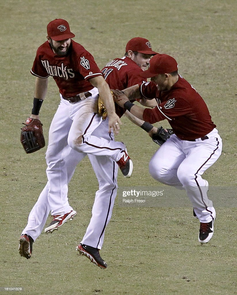 <a gi-track='captionPersonalityLinkClicked' href=/galleries/search?phrase=Adam+Eaton&family=editorial&specificpeople=210898 ng-click='$event.stopPropagation()'>Adam Eaton</a> #6, A.J. Pollock #11 and <a gi-track='captionPersonalityLinkClicked' href=/galleries/search?phrase=Gerardo+Parra&family=editorial&specificpeople=4959447 ng-click='$event.stopPropagation()'>Gerardo Parra</a> #8 of the Arizona Diamondbacks leap together in celebration of their 9-4 victory over the Los Angeles Dodgers during a MLB game at Chase Field on September 18, 2013 in Phoenix, Arizona.