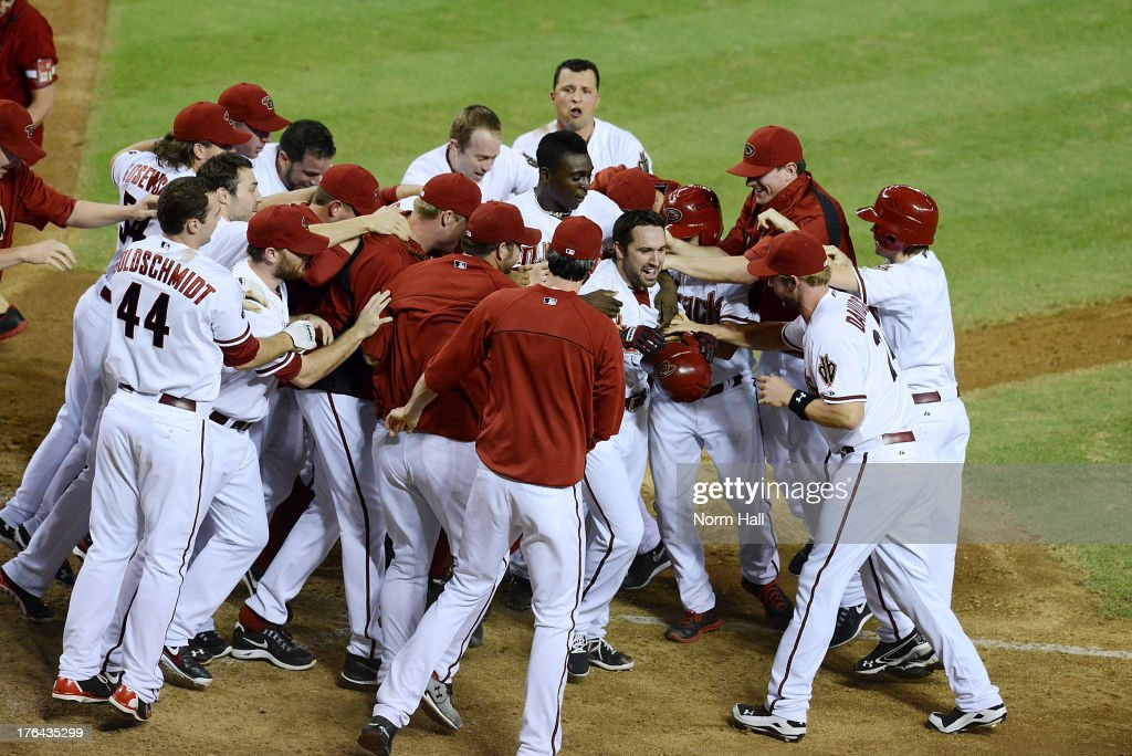 <a gi-track='captionPersonalityLinkClicked' href=/galleries/search?phrase=Adam+Eaton&family=editorial&specificpeople=210898 ng-click='$event.stopPropagation()'>Adam Eaton</a> #6 of the Arizona Diamondbacks and teammates celebrate a game-winning walk-off home run against the Baltimore Orioles at Chase Field on August 12, 2013 in Phoenix, Arizona. Arizona won 7-6.