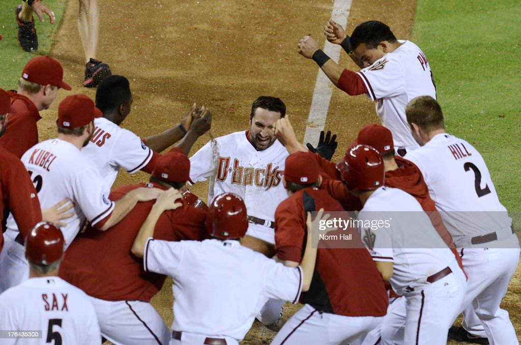 <a gi-track='captionPersonalityLinkClicked' href=/galleries/search?phrase=Adam+Eaton&family=editorial&specificpeople=210898 ng-click='$event.stopPropagation()'>Adam Eaton</a> #6 of the Arizona Diamondbacks and teammates celebrate a game-winning, walk-off home run against the Baltimore Orioles at Chase Field on August 12, 2013 in Phoenix, Arizona. Arizona won 7-6.