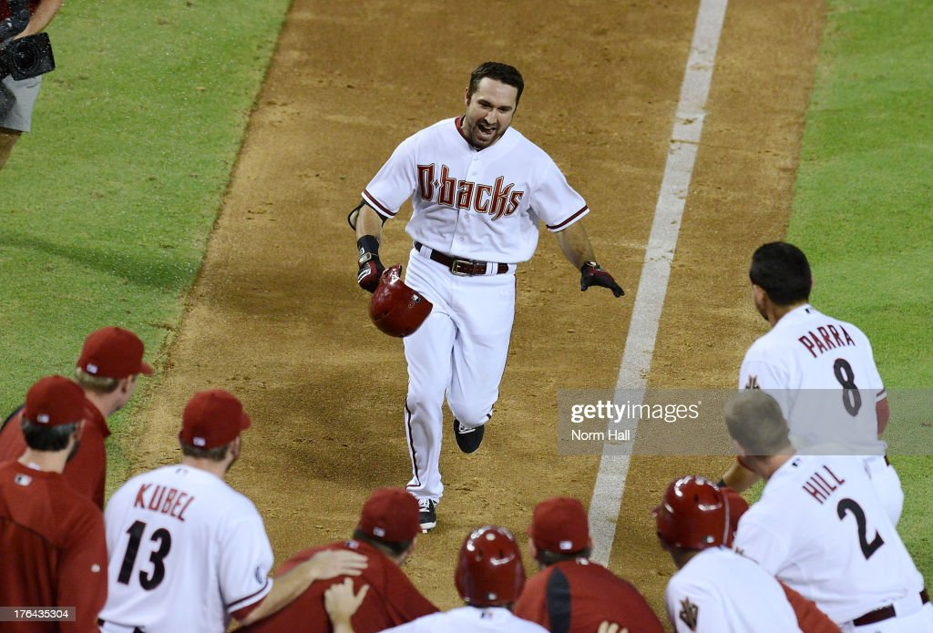 <a gi-track='captionPersonalityLinkClicked' href=/galleries/search?phrase=Adam+Eaton&family=editorial&specificpeople=210898 ng-click='$event.stopPropagation()'>Adam Eaton</a> #6 of the Arizona Diamondbacks and teammates celebrate his game-winning, walk-off home run against the Baltimore Orioles at Chase Field on August 12, 2013 in Phoenix, Arizona. Arizona won 7-6.