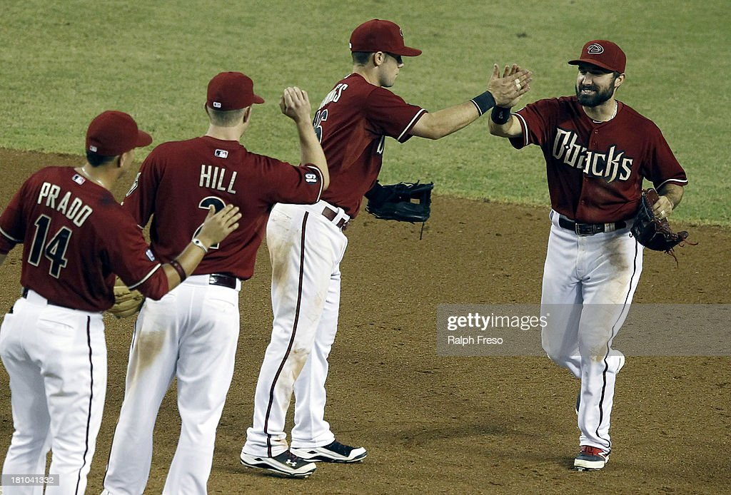<a gi-track='captionPersonalityLinkClicked' href=/galleries/search?phrase=Adam+Eaton&family=editorial&specificpeople=210898 ng-click='$event.stopPropagation()'>Adam Eaton</a> #6 (R) of the Arizona Diamondbacks is congratulated by teammates Chris Owings #16, <a gi-track='captionPersonalityLinkClicked' href=/galleries/search?phrase=Aaron+Hill+-+Baseball+Player&family=editorial&specificpeople=239242 ng-click='$event.stopPropagation()'>Aaron Hill</a> #2 and <a gi-track='captionPersonalityLinkClicked' href=/galleries/search?phrase=Martin+Prado&family=editorial&specificpeople=620159 ng-click='$event.stopPropagation()'>Martin Prado</a> #14 following their 9-4 victory over the Los Angeles Dodgers during a MLB game at Chase Field on September 18, 2013 in Phoenix, Arizona.