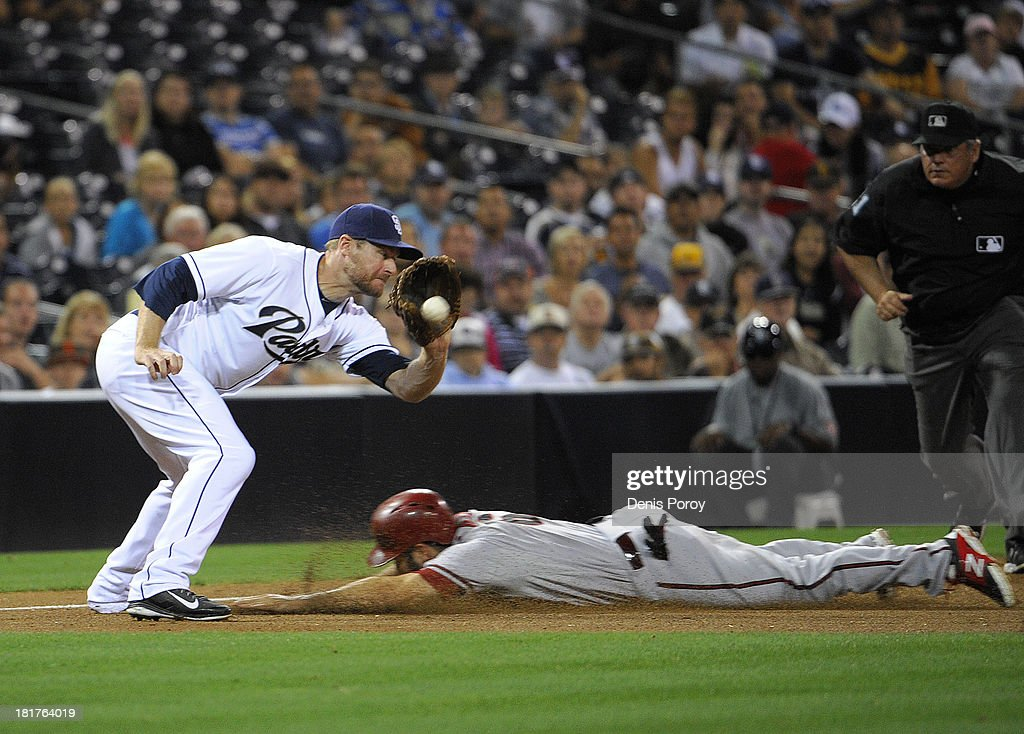 <a gi-track='captionPersonalityLinkClicked' href=/galleries/search?phrase=Adam+Eaton&family=editorial&specificpeople=210898 ng-click='$event.stopPropagation()'>Adam Eaton</a> #6 of the Arizona Diamondbacks is tagged out by <a gi-track='captionPersonalityLinkClicked' href=/galleries/search?phrase=Chase+Headley&family=editorial&specificpeople=4353228 ng-click='$event.stopPropagation()'>Chase Headley</a> #7 of the San Diego Padres as he slides into third base during the sixth inning of a baseball game at Petco Park on September 24, 2013 in San Diego, California.