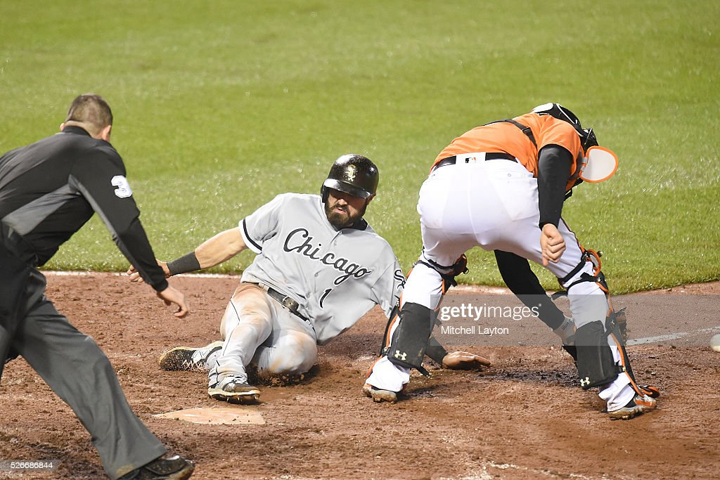 Adam Eaton #1 of the Chicago White Sox beats the tag by Matt Wieters #32 of the Baltimore Orioles on a Melky Cabrera #53 (not pictured) to score game winning single in the ninth inning during a baseball game at Oriole Park at Camden yards on April 30, 2016 in Baltimore, Maryland. The White Sox won 8-7.