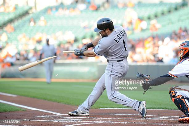Adam Eaton of the Chicago White Sox breaks his bat during a baseball game against the Baltimore Orioles on June 23 2014 at Oriole Park at Camden...