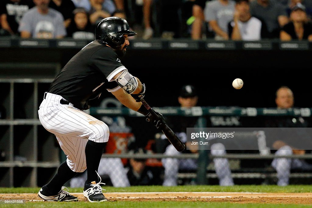 Adam Eaton of the Chicago White Sox bunts for a single against the Philadelphia Phillies during the third inning at US Cellular Field on August 23...