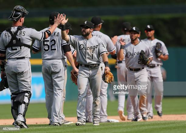 Adam Eaton of the Chicago White Sox celebrates a win over the Detroit Tigers with Kyle Flowers at Comerica Park on July 31 2014 in Detroit Michigan...