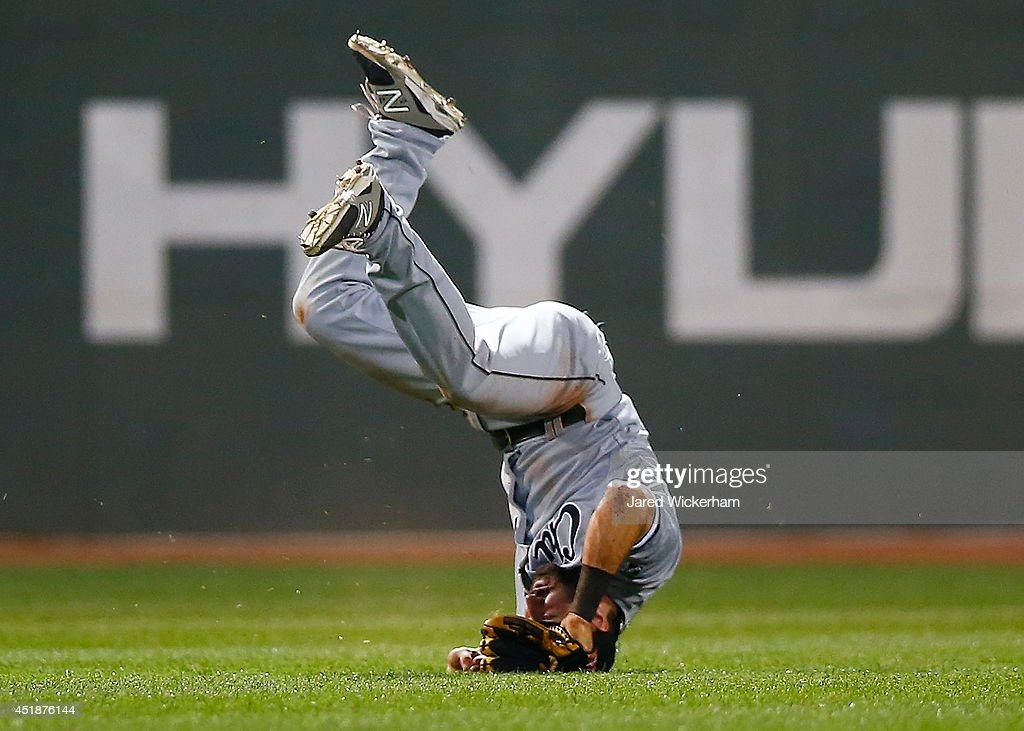 <a gi-track='captionPersonalityLinkClicked' href=/galleries/search?phrase=Adam+Eaton&family=editorial&specificpeople=210898 ng-click='$event.stopPropagation()'>Adam Eaton</a> #1 of the Chicago White Sox fails to come up with the catch in center field against the Boston Red Sox during the game at Fenway Park on July 8, 2014 in Boston, Massachusetts.