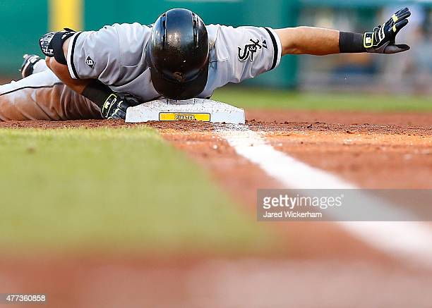 Adam Eaton of the Chicago White Sox gestures with his head on first base after running back to the base following a fly ball in the second inning...
