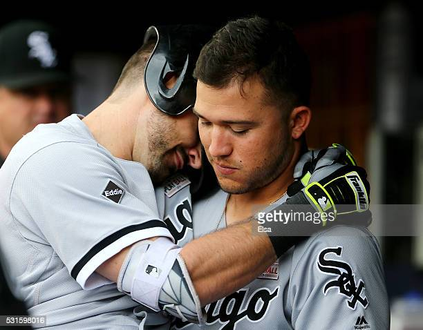 Adam Eaton of the Chicago White Sox is congratulated by teammate Carlos Sanchez of the Chicago White Sox in the dugout after Eaton hit a solo home...