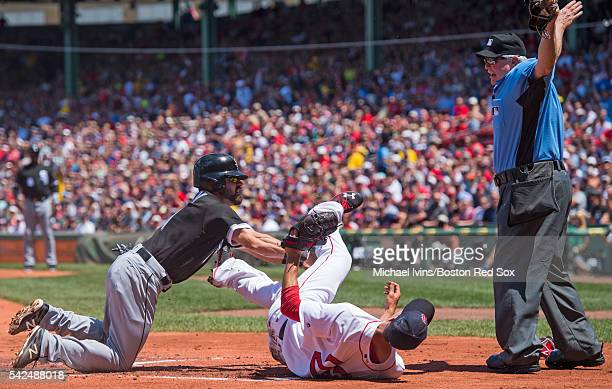 Adam Eaton of the Chicago White Sox is ruled safe at home by umpire Dana DeMuth after a past ball by Rick Porcello of the Boston Red So in the first...