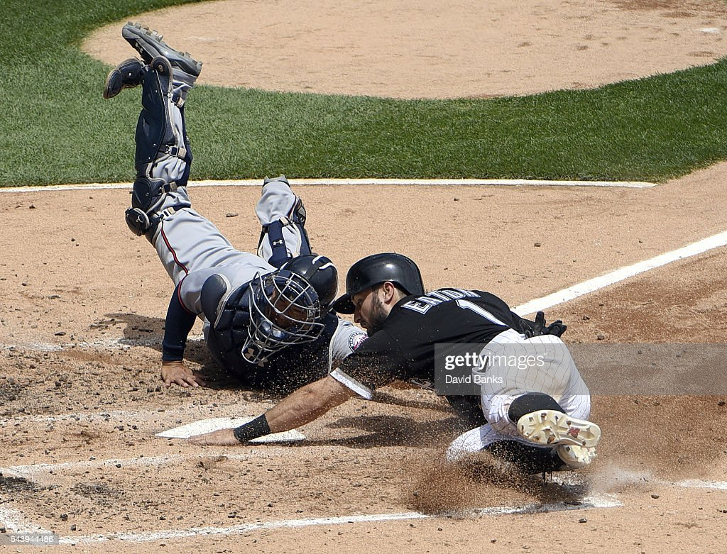 <a gi-track='captionPersonalityLinkClicked' href=/galleries/search?phrase=Adam+Eaton&family=editorial&specificpeople=210898 ng-click='$event.stopPropagation()'>Adam Eaton</a> #1 of the Chicago White Sox is safe at home as <a gi-track='captionPersonalityLinkClicked' href=/galleries/search?phrase=Kurt+Suzuki&family=editorial&specificpeople=682702 ng-click='$event.stopPropagation()'>Kurt Suzuki</a> #8 of the Minnesota Twins makes a late tag during the third inning on June 30, 2016 at U. S. Cellular Field in Chicago, Illinois.
