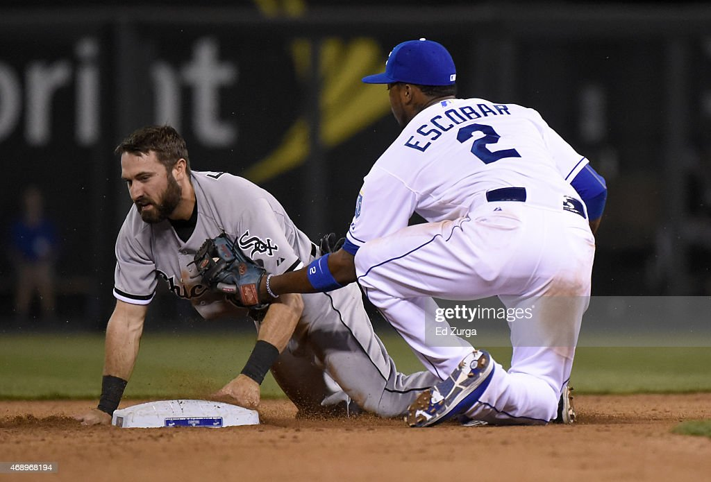 Adam Eaton #1 of the Chicago White Sox is tagged out by Alcides Escobar #2 of the Kansas City Royals as he tries to steal in the seventh inning on April 8, 2015 at Kauffman Stadium in Kansas City, Missouri.