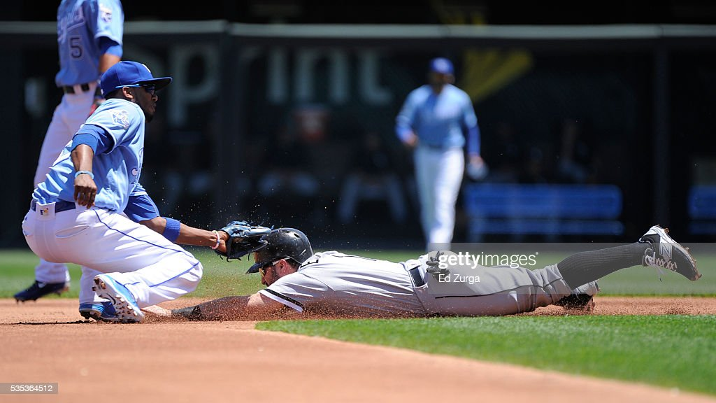 Adam Eaton #1 of the Chicago White Sox is tagged out by Alcides Escobar #2 of the Kansas City Royals as he tries to steal in the first inning at Kauffman Stadium on May 29, 2016 in Kansas City, Missouri.