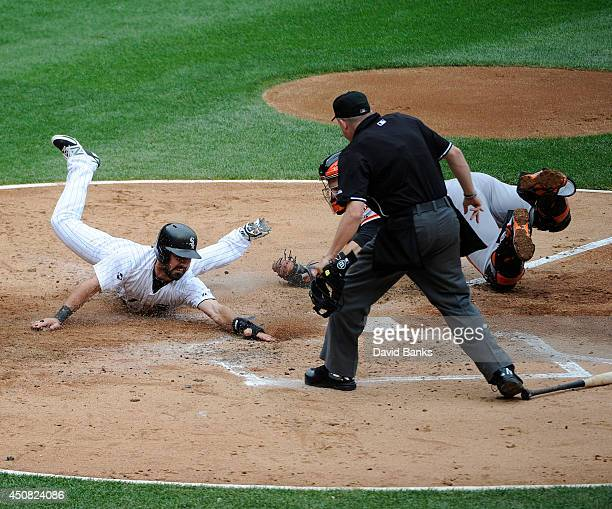 Adam Eaton of the Chicago White Sox is tagged out by Buster Posey of the San Francisco Giants during the third inning on June 18 2014 at US Cellular...