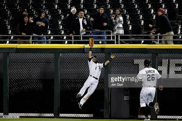 Adam Eaton of the Chicago White Sox is unable to make a leaping catch against the Cleveland Indians during the eighth inning on April 21 2015 at US...