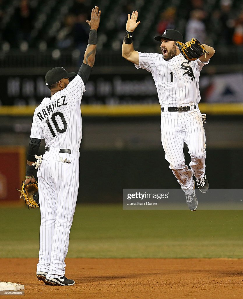 <a gi-track='captionPersonalityLinkClicked' href=/galleries/search?phrase=Adam+Eaton&family=editorial&specificpeople=210898 ng-click='$event.stopPropagation()'>Adam Eaton</a> #1 of the Chicago White Sox leaps to celebrate with <a gi-track='captionPersonalityLinkClicked' href=/galleries/search?phrase=Alexei+Ramirez&family=editorial&specificpeople=690568 ng-click='$event.stopPropagation()'>Alexei Ramirez</a> #10 after a win over the Cleveland Indians at U.S. Cellular Field on April 10, 2014 in Chicago, Illinois. The White Sox defeated the Indians 7-3.