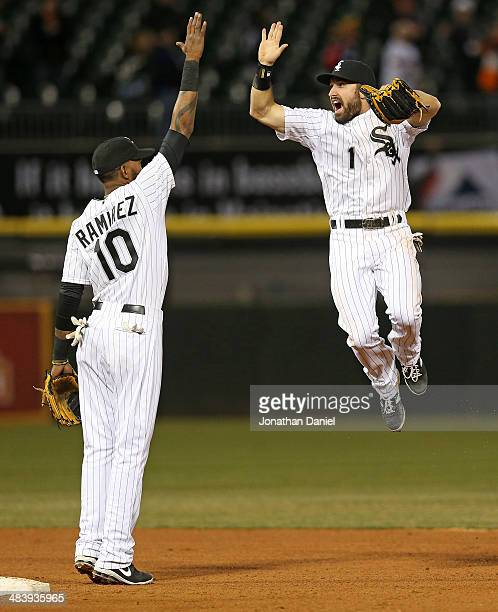 Adam Eaton of the Chicago White Sox leaps to celebrate with Alexei Ramirez after a win over the Cleveland Indians at US Cellular Field on April 10...