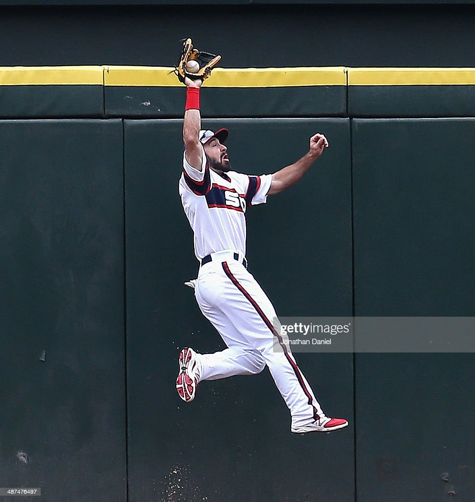 <a gi-track='captionPersonalityLinkClicked' href=/galleries/search?phrase=Adam+Eaton&family=editorial&specificpeople=210898 ng-click='$event.stopPropagation()'>Adam Eaton</a> #1 of the Chicago White Sox makes a catch in the 1st inning on a fly ball hit by Torii Hiunter of the Detroit Tigers at U.S. Cellular Field on April 30, 2014 in Chicago, Illinois.