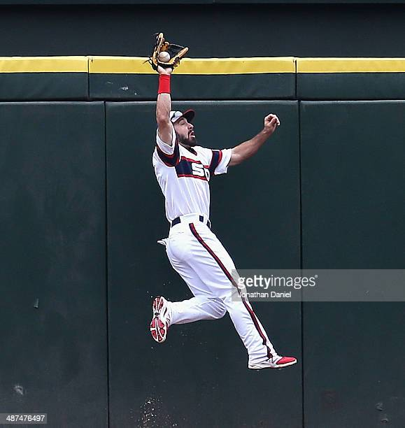 Adam Eaton of the Chicago White Sox makes a catch in the 1st inning on a fly ball hit by Torii Hiunter of the Detroit Tigers at US Cellular Field on...