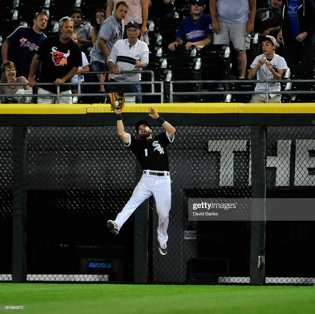 <a gi-track='captionPersonalityLinkClicked' href=/galleries/search?phrase=Adam+Eaton&family=editorial&specificpeople=210898 ng-click='$event.stopPropagation()'>Adam Eaton</a> #1 of the Chicago White Sox makes a catch on Kole Calhoun (not pictured) of the Los Angeles Angels of Anaheim in the eighth inning during the second game of a doubleheader on July 1, 2014 at U.S. Cellular Field in Chicago, Illinois.