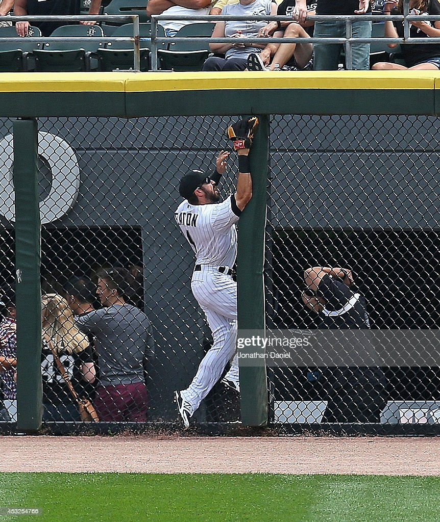<a gi-track='captionPersonalityLinkClicked' href=/galleries/search?phrase=Adam+Eaton&family=editorial&specificpeople=210898 ng-click='$event.stopPropagation()'>Adam Eaton</a> #1 of the Chicago White Sox runs into the fence trying to make a catch of a home run ball hit by Adam Rosales of the Texas Rangers in the 2nd inning at U.S. Cellular Field on August 6, 2014 in Chicago, Illinois. Eaton was injured and left the game.