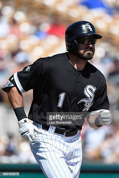 Adam Eaton of the Chicago White Sox runs to first base against the Los Angeles Angels of Anaheim at Camelback Ranch on March 15 2015 in Glendale...